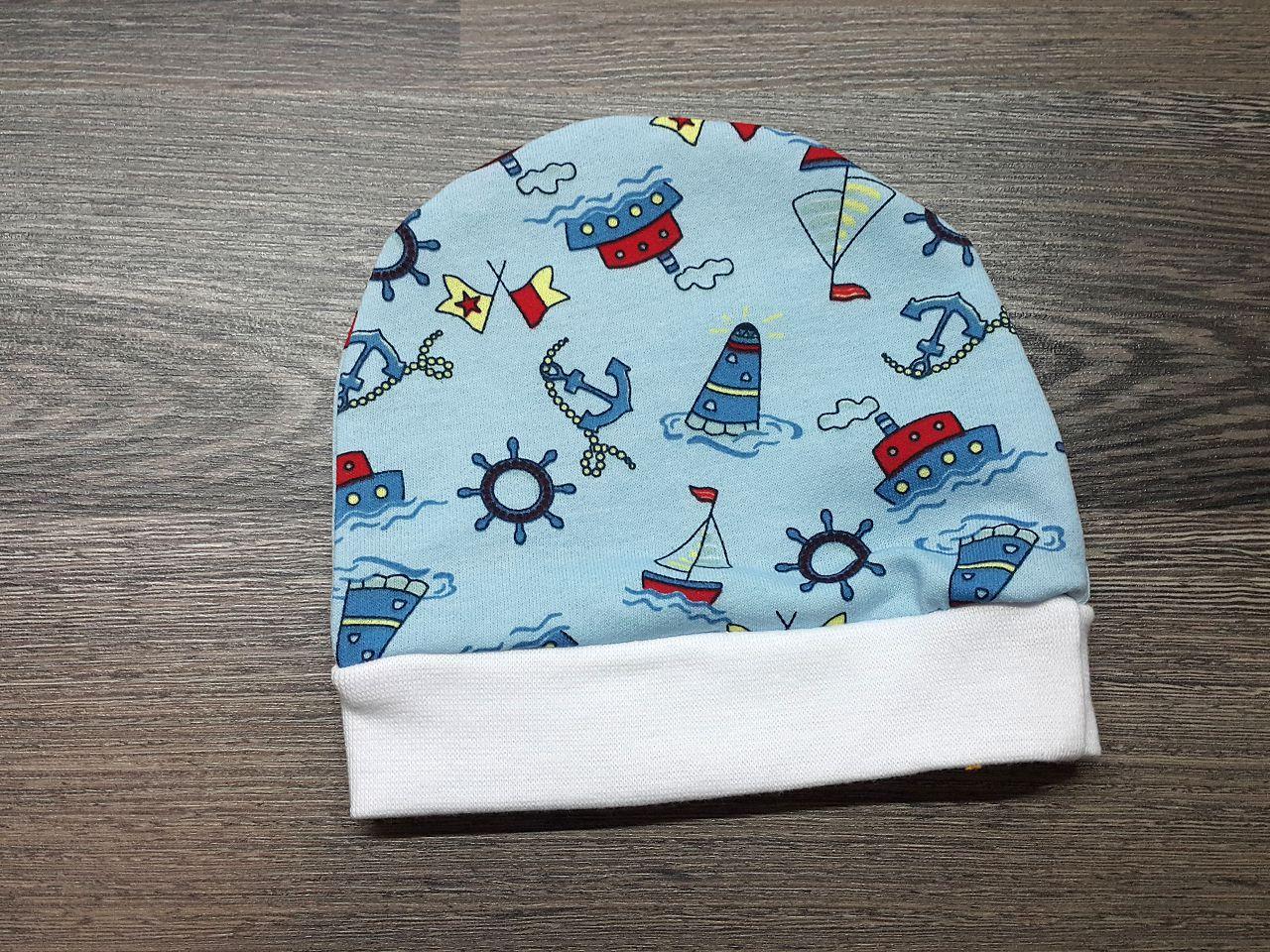 Шапочка детская тёплая голубая с кораблями
